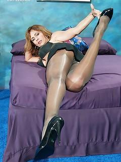 Gorgeous MILF Monique Fuentes posing in pantyhose.