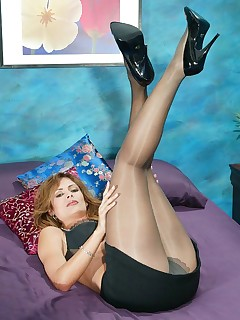 Gorgeous MILF Monique Fuentes posing in pantyhose.