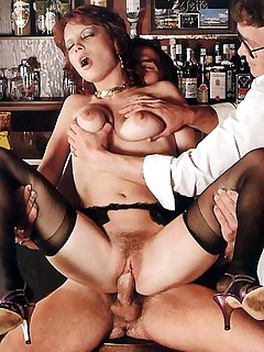 Retro porn ~ Two guys in a bar fucking a retro lady!