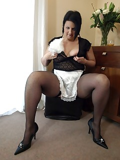 Hot MILF dressed as a slutty maid in seamed polka dot stockings.